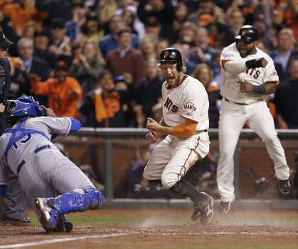 Hunter Pence (center) and Pablo Sandoval of the Giants exult after scoring runs in the eighth inning on a double by Juan Perez, who reached third on a throwing error. Perez scored on Brandon Crawford's single. Photo: Scott Strazzante / San Francisco Chronicle / ONLINE_YES