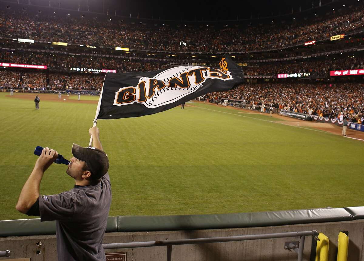 Giants fan Pat O'rourke, of Walnut Creek runs the bleachers with a flag during the 8th inning during game five of the World Series against the Kansas City Royals at AT&T Park on Sunday Oct. 26, 2014 in San Francisco, Calf. Final score 5-0 Giants.