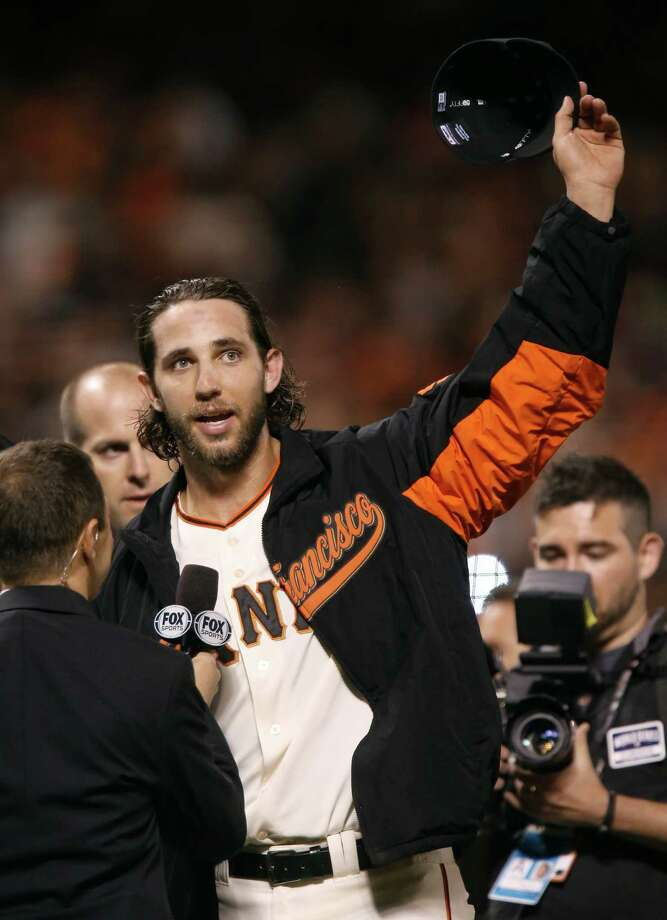 Giants Madison Bumgarner waves to the crowd after his winning 5 to 0 performance over the Kansas City Royals in Game 5 of the World Series at AT&T Park on Sunday, Oct. 26, 2014 in San Francisco, Calif. Photo: Michael Macor / The Chronicle / ONLINE_YES