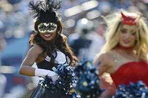 Tennessee Titans cheerleaders, dressed in Halloween costumes, perform in the fourth quarter of an NFL football game against the Houston Texans Sunday, Oct. 26, 2014, in Nashville, Tenn. (AP Photo/Mark Zaleski)
