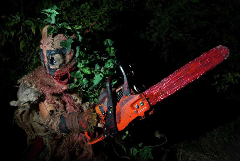 A chain saw baring zombie scares guest at Creepy Hollow. Photo: J. Patric Schneider, Freelance / © 2014 Houston Chronicle