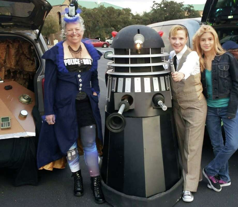 "Tina Edwards Sanchez (left) as ""Doctor Who's"" TARDIS and her son Dylan as a Dalek (second from left) alongside friends dressed as the Tenth Doctor (Dama Alvarado) and companion Rose (Isabella Alvarado, far right) for Halloween 2013. Photo: Courtesy Tina Edwards Sanchez / Courtesy Tina Edwards Sanchez / Courtesy"