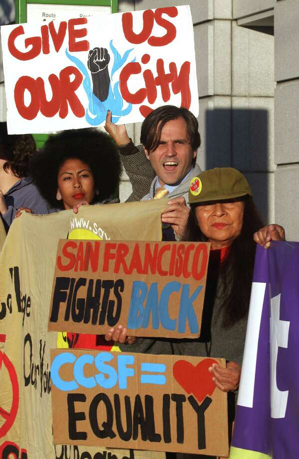 Educators and students including president of the Black Student Union Thea Matthews (left), student Keith Kimber (middle), and teacher Ana Chavez Fisher (right) of child development in family studies rally in support of CCSF and public education in front of the California State Superior Courthouse in San Francisco, Calif., on Monday, October 27, 2014. Photo: Liz Hafalia / The Chronicle / ONLINE_YES