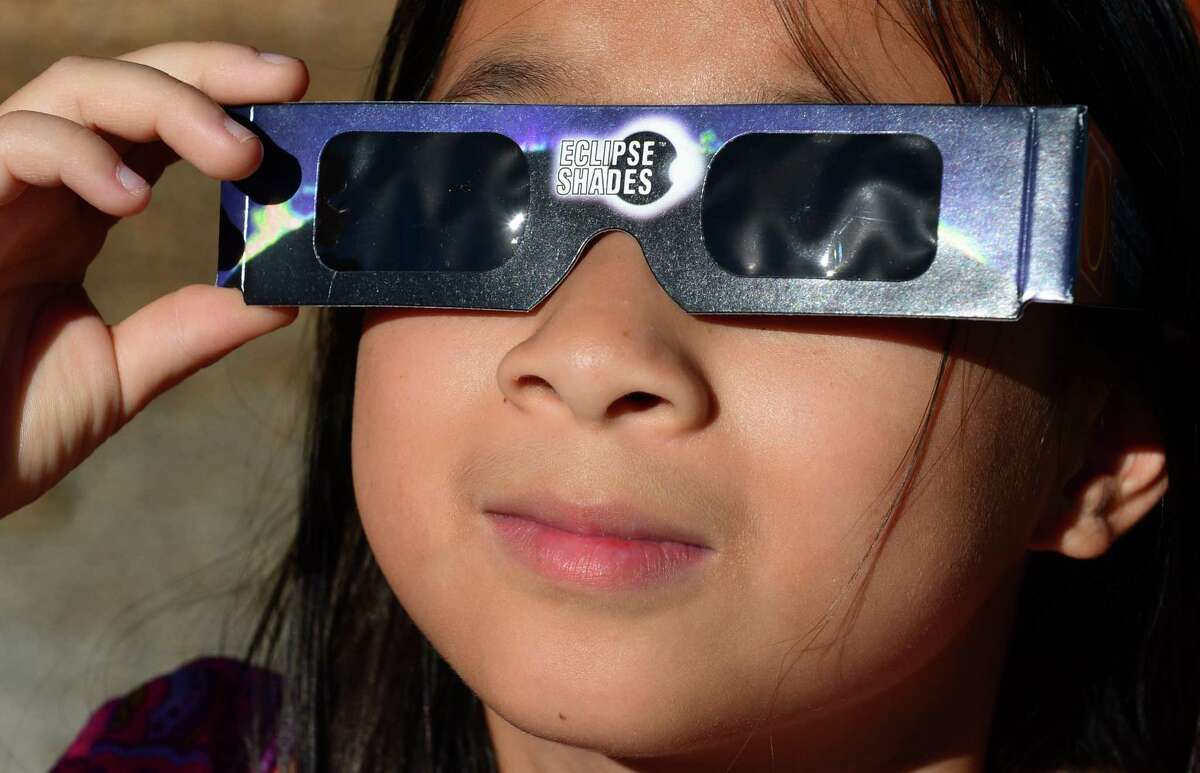 Leianna Stout, 8, uses protective eye wear to view a partial eclipse of the sun near the Mount Wilson Observatory on Mt. Wilson, a 5,710-foot peak in the San Gabriel Mountains northeast of Los Angeles. Solar eclipses occur when the moon, sun and Earth are aligned in such a way that from a portion of the Earth, the shadow of the moon blocks out the sun and in a case as today during a partial eclipse, the sun is never entirely obscured by the moon. AFP PHOTO / Frederic J. BROWNFREDERIC J. BROWN/AFP/Getty Images