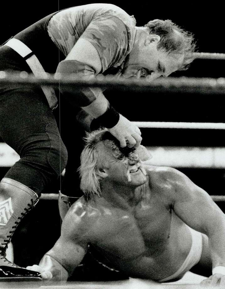 The hustler gets slaughtered; The villainous Sergeant Slaughter gouges Hulk Hogan's eyes in WWF championship match last night at the Gardens. Photo: Bull; Ron, Getty Images / Toronto Star