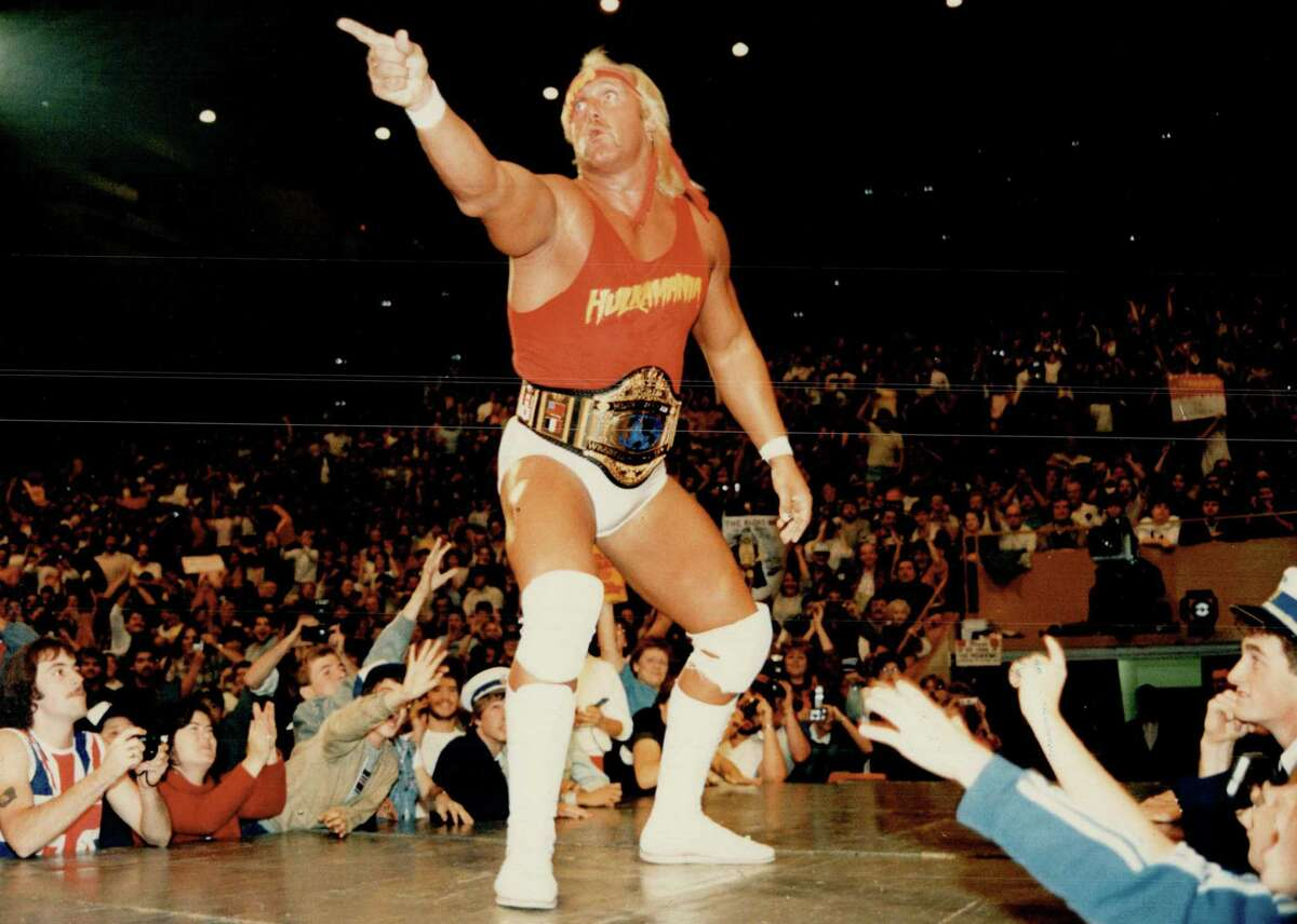 Hulking defiance: Hulk Hogan; all 6-foot-7 inches and 307 pounds of him; stands before his adoring audience at Maple Leaf Gardens last night before a joust with Macho Man Randy Savage in which the Hulk emerged triumphant despite in questionable tactics of