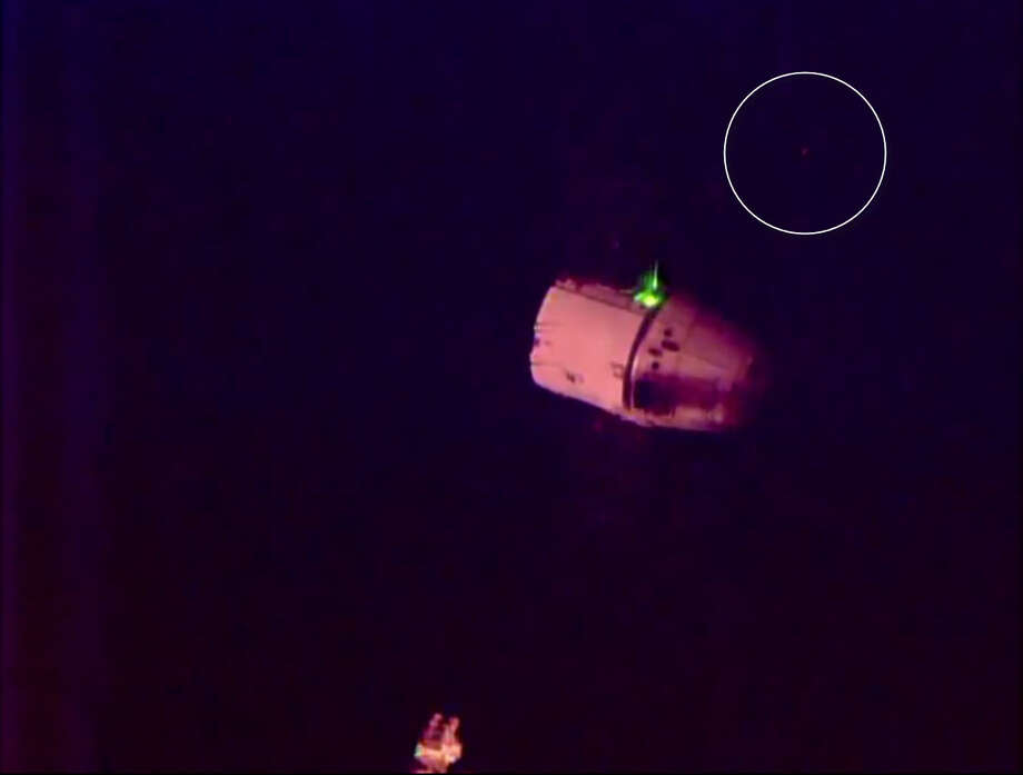 A blinking light behind a Space X cargo ship disembarking from the International Space Station gave UFO conspiracy theorists something to chatter about.