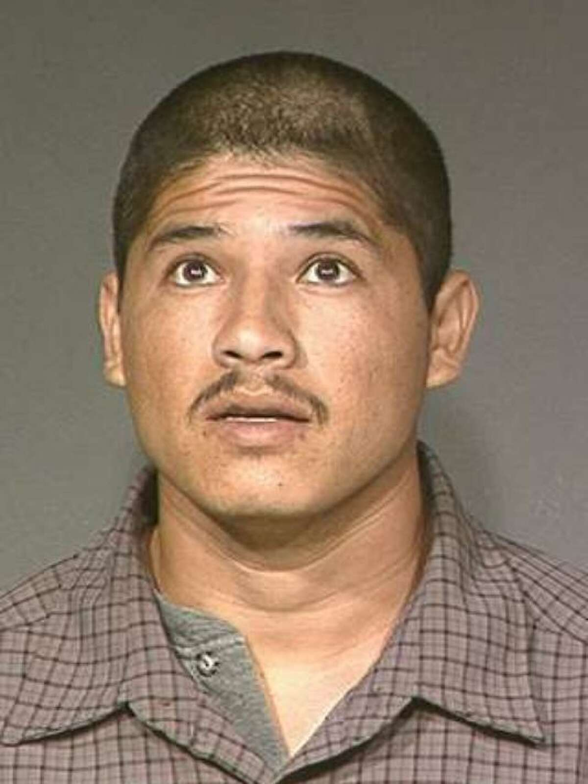 FILE-- Luis Enrique Monroy-Bracamonte. Monroy-Bracamonte who was arrested in the 2014 killings of two Northern California deputies appeared in court Tuesday, laughing, smiling and shouting out that a deputy was a coward as the prosecution laid out the timeline of the crime spree that spanned Sacramento and Placer counties.
