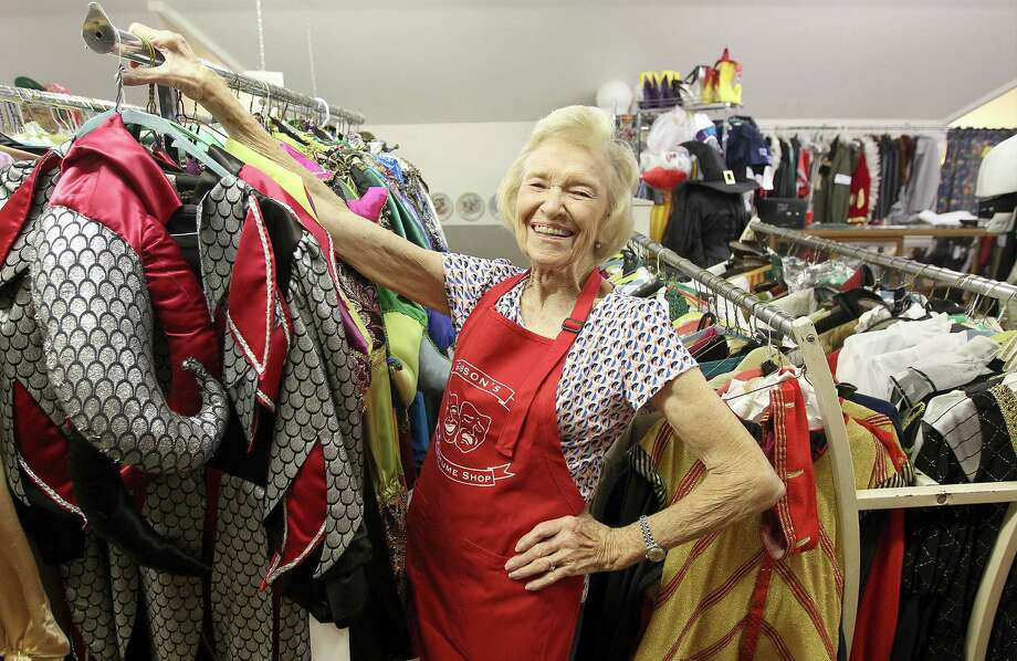 """Annette Younger owns Gibson Costume Co., the oldest such shop in town. Her get-ups, she said, """"bring out the kid inside """"an adult."""" Photo: Kin Man Hui / Kin Man Hui / San Antonio Express-News / ©2014 San Antonio Express-News"""