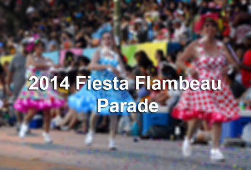 Photos from the Fiesta Flambeau Parade in 2014.