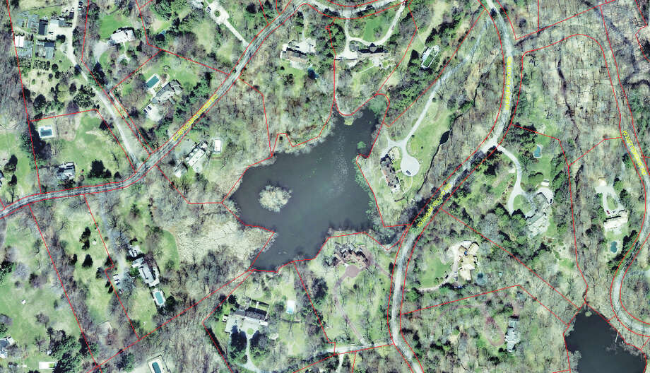 Aerial photo of Khakum Wood Lake in Greenwich, Conn. also known as Golden Pond, taken before a dredging project show the disappearance of a quarter-acre island in the  middle of the 6-acre lake. Photo: Contributed Photo, Greenwich Geographic Information / Greenwich Time Contributed