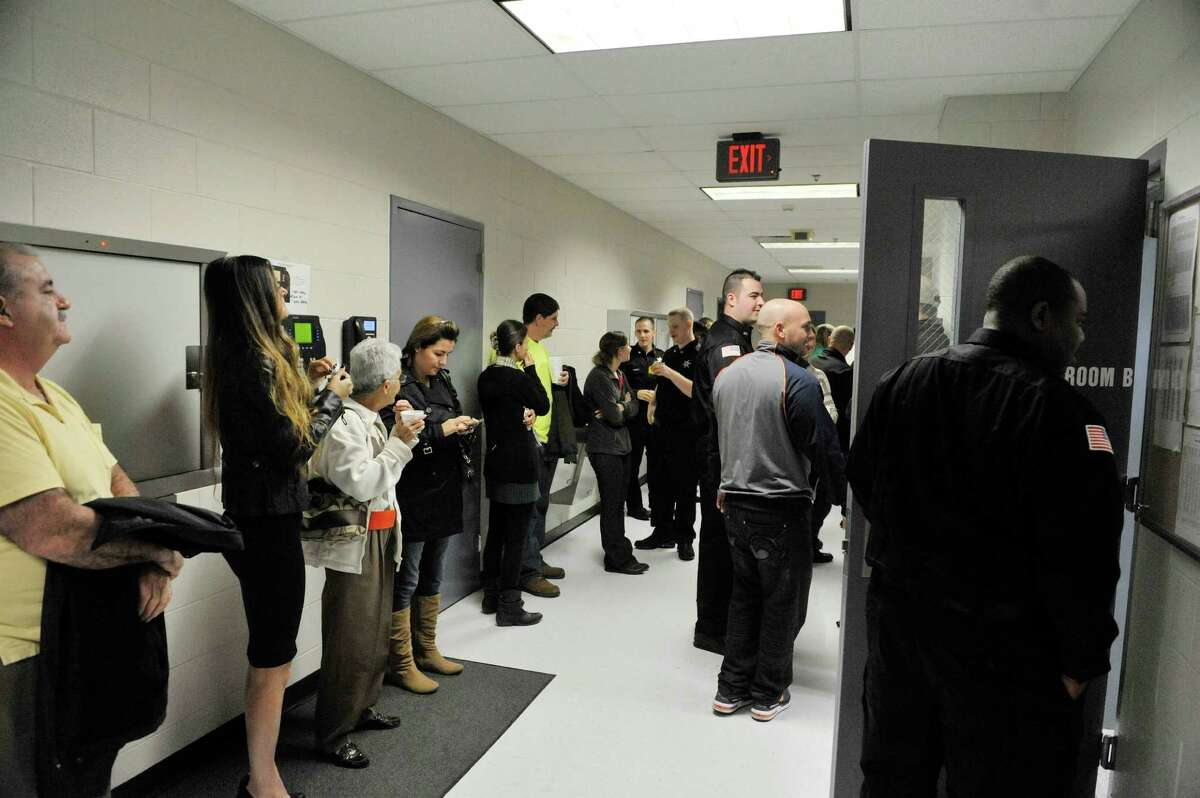Family and friends of newly sworn-in correctional officers visit with each other following a ceremony where 12 new correctional officer were sworn in at the Rensselaer County Jail on Monday, Oct. 27, 2014, in Troy, N.Y. (Paul Buckowski / Times Union)