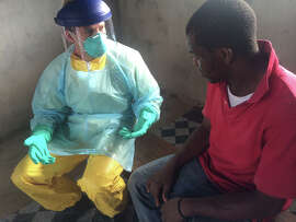 Dr. Dan Kelly, an infectious disease specialist affiliated with UCSF, maintains the Wellbody Alliance clinic in the Kono District, Sierra Leone, speaks with Sorie, who may have been exposed to Ebola.