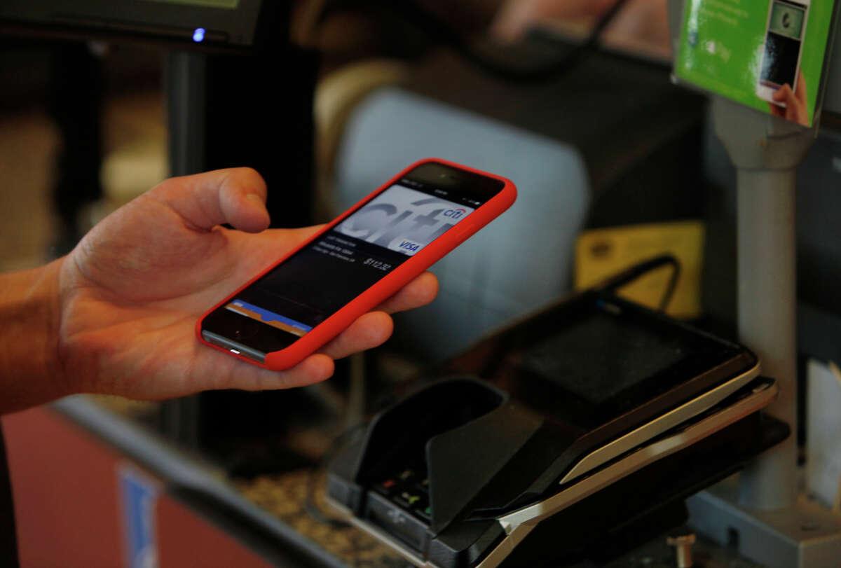 Leo Romanovsky, of San Francisco uses Apple Pay at Whole Foods Market in San Francisco last week.