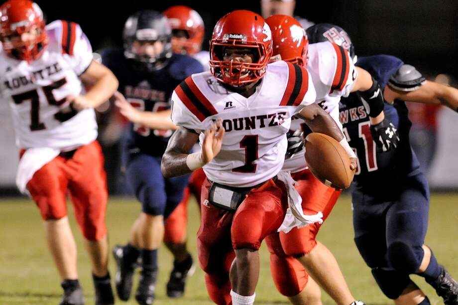 Kountze Lions Quaterback Grayland Arnold, 1, scrambles down field at the Hawk Stadium Friday night. Photo by Drew Loker. Photo: Drew Loker