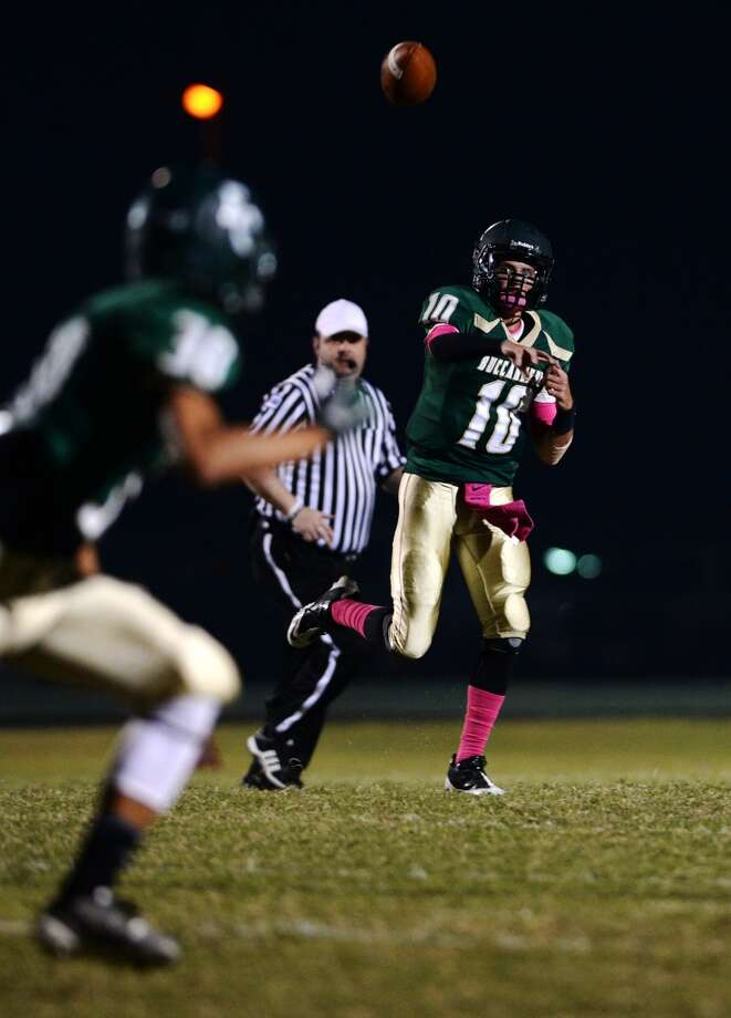 East Chambers' Austin Sutherland, No. 10, passes toward a receiver during Friday night's game against Buna. The East Chambers Buccaneers hosted the Buna Cougars in a District 12-3A DI match up on Friday night. Photo taken Friday 10/24/14 Jake Daniels/@JakeD_in_SETX Photo: Jake Daniels