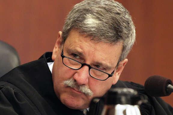 Superior Court Judge Curtis Karnow listens as teacher Alisa Messer testifies on the stand.