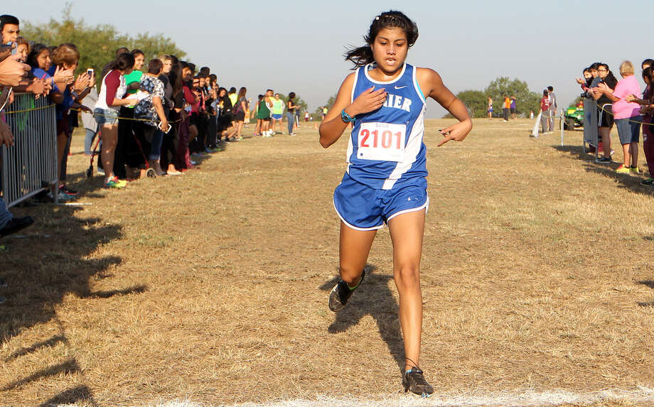 Lanier's Jovana Espinoza crosses the finish line of the Girls 3 Mile Run during the District 28-5A Cross Country Meet  Friday. Espinoza won the event with a time of 20 minutes, 39.85 seconds. Photo: Marvin Pfeiffer / EN Communities / EN Communities 2014