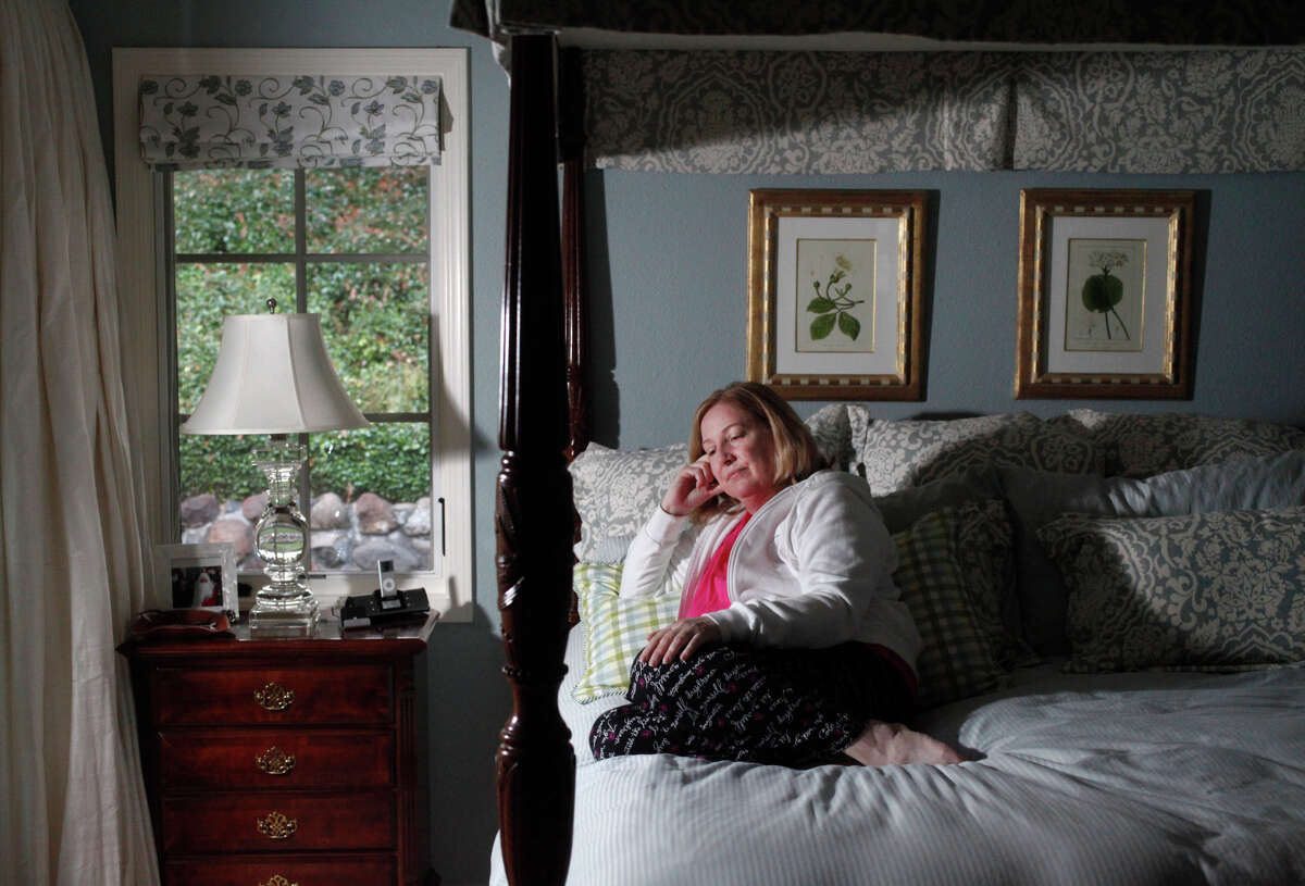Susan Kreutzer, 58, pictured in her home Oct. 25, 2014 in Danville, Calif. Kreutzer says she feels like her life has been stolen from her since she came down with what she thought was the flu in 1991. A young lawyer at the time, she toughed it out for months, but she never seemed to recover. Over the past few years, she has oscillated between really sick and somewhat sick but always exhausted. She's seen doctors and specialists over the years, mostly concerning her thyroid, which she had removed once it was discovered it had cancer in 2006. Kreutzer never fully recovered and in fact got worse in 2008. That was the first time she started timidly asking about Chronic Fatigue Syndrome, knowing the term had a stigma attached to it. Doctors told her not to go there, but she was desperate for answers,