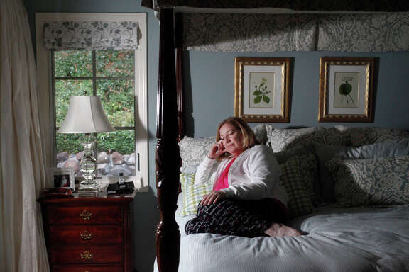 "Susan Kreutzer, 58, pictured in her home Oct. 25, 2014 in Danville, Calif. Kreutzer says she feels like her life has been stolen from her since she came down with what she thought was the flu in 1991. A young lawyer at the time, she toughed it out for months, but she never seemed to recover. Over the past few years, she has oscillated between really sick and somewhat sick but always exhausted. She's seen doctors and specialists over the years, mostly concerning her thyroid, which she had removed once it was discovered it had cancer in 2006. Kreutzer never fully recovered and in fact got worse in 2008. That was the first time she started timidly asking about Chronic Fatigue Syndrome, knowing the term had a stigma attached to it. Doctors told her not to go there, but she was desperate for answers, ""my life is ending,"" she thought. Finally, in 2012, she found a doctor who was willing to give her antiviral drugs associated with the mysterious illness. At the time, she was only awake about three hours of the day and the sleep she did get was restless. ""There's fatigue, but this is not regular fatigue,"" she said, ""this is beyond any kind of fatigue you've ever experienced."" 10 weeks to the day of starting the antivirals, she says she ""rose from the dead"". For the first time in years, she was starting to feel good again. But in Kreutzer's excitement in feeling better, she wore her body out quickly and fell ill again. She's now in a stable enough place that she plans to start taking the antiviral drugs again and is hoping for ""remission"" from the illness she prefers to call Myalgic Encephalomyelitis."