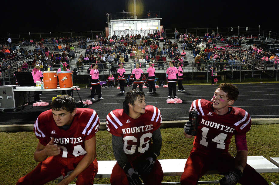 Kountze's players talk as they take in the action with Woodville during Friday's home game. Photo taken Friday, October 24, 2014 Kim Brent/@kimbpix Photo: Kim Brent / Beaumont Enterprise