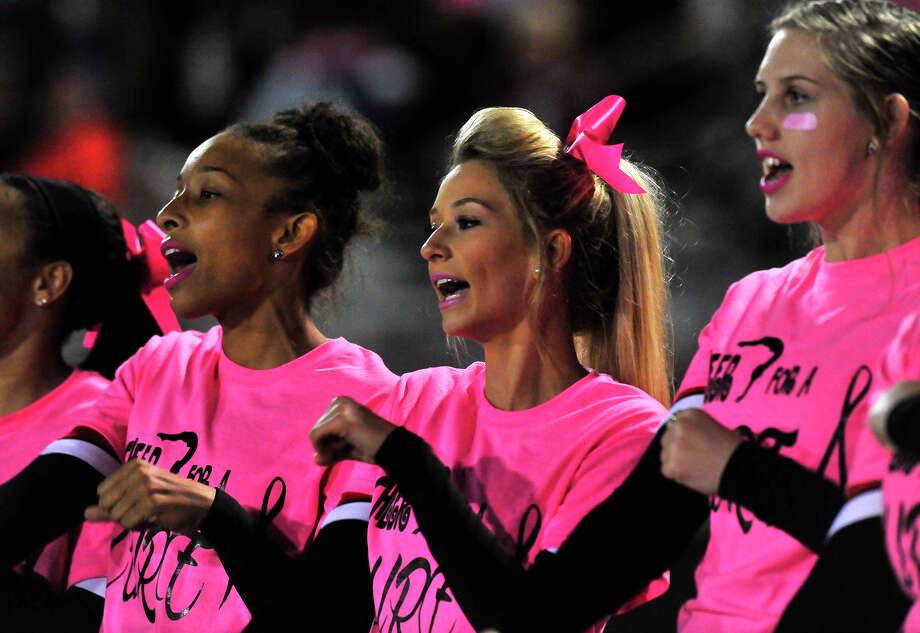 Kountze's cheerleaders are decked out in pink gear during Friday's home game against Woodville. Photo taken Friday, October 24, 2014 Kim Brent/@kimbpix Photo: Kim Brent / Beaumont Enterprise