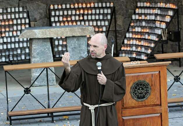 """Rev. Larry Anderson presides over the annual """"Blessing of the Athletes""""  ceremony at The Grotto at Siena College on Monday, Oct. 27, 2014 in Loudonville, N.Y. (Lori Van Buren / Times Union) Photo: Lori Van Buren / 00029221A"""
