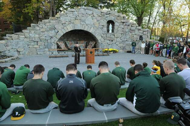 """Siena athletes bow their heads as Rev. Larry Anderson, center, presides over the annual """"Blessing of the Athletes""""  ceremony  at The Grotto at Siena College on Monday, Oct. 27, 2014 in Loudonville, N.Y. (Lori Van Buren / Times Union) Photo: Lori Van Buren / 00029221A"""