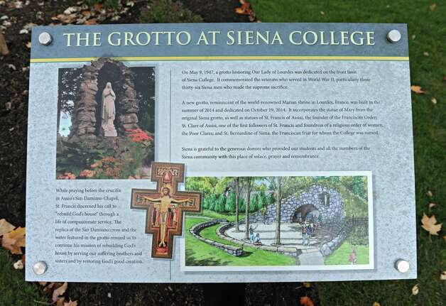 Sign at The Grotto at Siena College on Monday, Oct. 27, 2014 in Loudonville, N.Y. The Grotto is modeled after the famous shrine in Lourdes, France. Siena's structure incorporates the spirit of the original with a miniature stream and candles sheltered under a stone arch. (Lori Van Buren / Times Union) Photo: Lori Van Buren / 00029221A