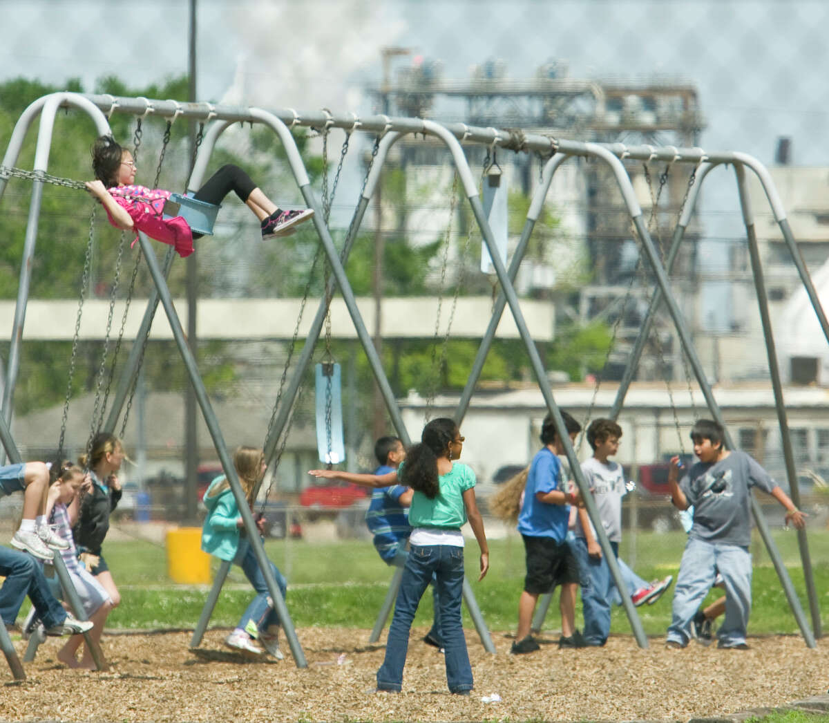 Students play on swing sets, outside of San Jacinto Elementary School in Deer Park (601 E. 8th Street, which is located across 255 from refineries.) Tuesday, March 31, 2009. ( Karen Warren / Chronicle )