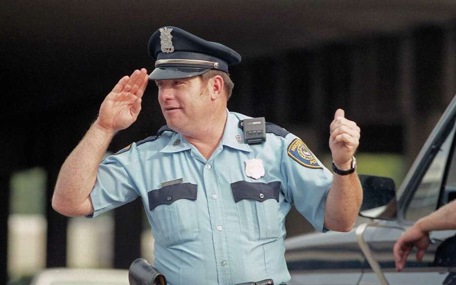 "10/22/1985 - Houston Police Officer A.F. ""Buzz Saw"" Jones directs traffic at Loop 610