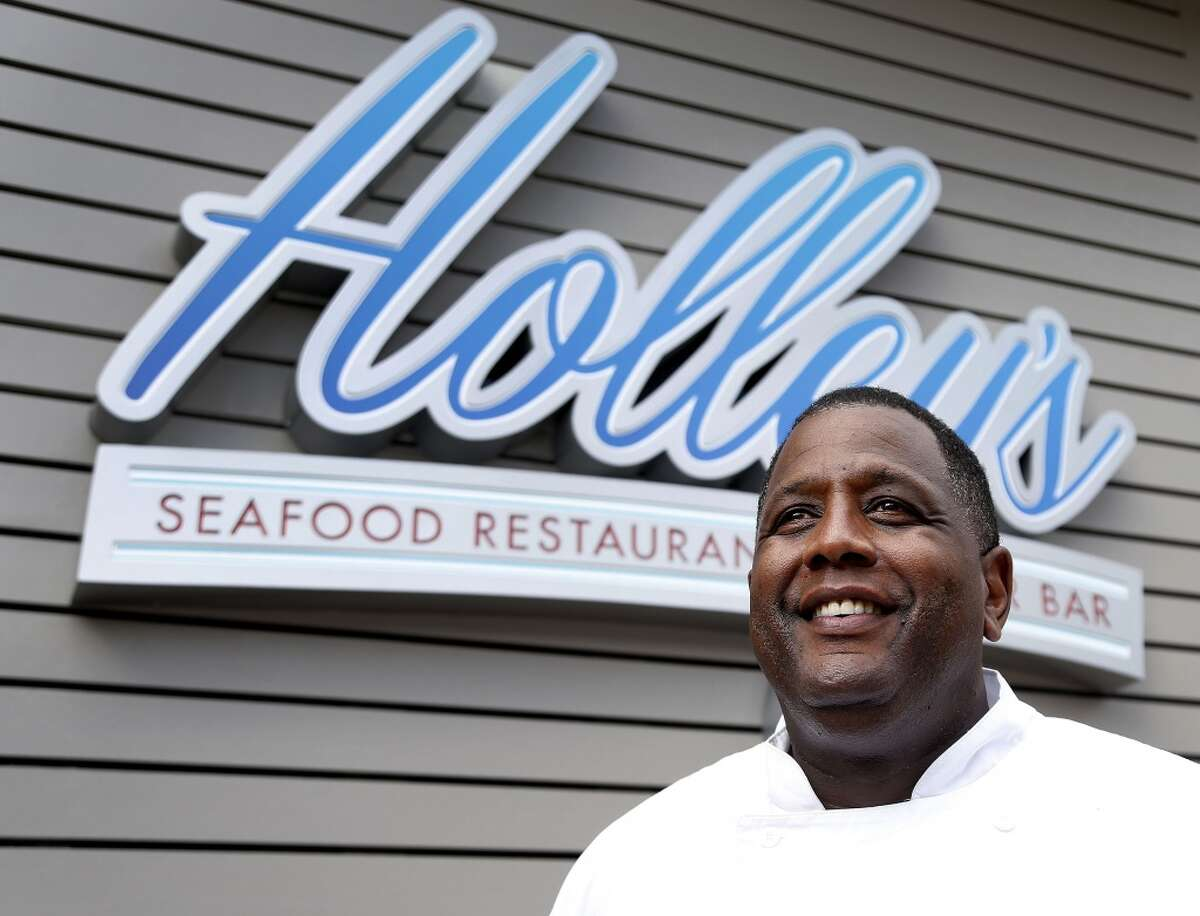 Chef Mark Holley stands outside of his new restaurant, Holley's Seafood Restaurant & Oyster Bar, at the corner of Louisiana and Elgin, Friday, June 27, 2014. The restaurant closed on Oct. 1, 2017.
