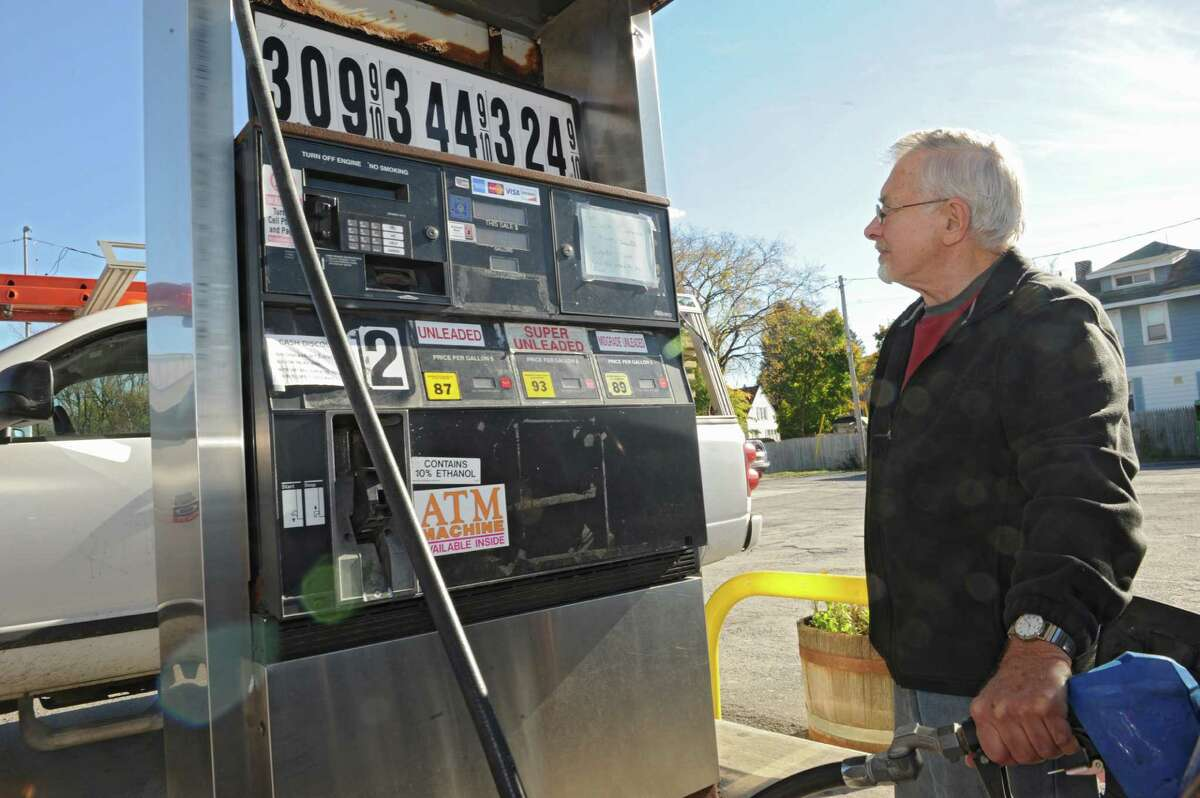 John Rizzo of Albany was happy with the price of $3.09 a gallon for regular gas at the Petrol gas station on 9W Monday, Oct. 27, 2014, in Glenmont, N.Y. (Lori Van Buren / Times Union)