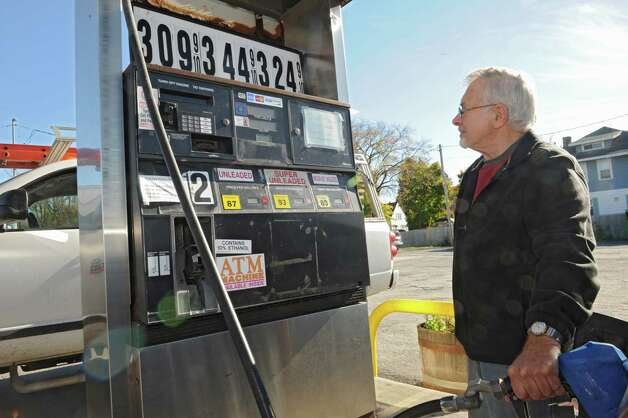 John Rizzo of Albany was happy with the price of $3.09 a gallon for regular gas at the Petrol gas station on 9W  Monday, Oct. 27, 2014, in Glenmont, N.Y. (Lori Van Buren / Times Union) Photo: Lori Van Buren / 00029215A