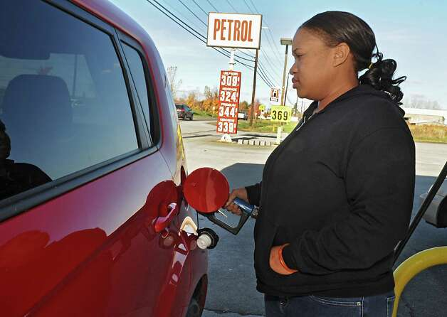 Amina Coleman of Albany was happy with the price of $3.09 a gallon for regular gas at the Petrol gas station on 9W Monday, Oct. 27, 2014, in Glenmont, N.Y. (Lori Van Buren / Times Union) Photo: Lori Van Buren / 00029215A