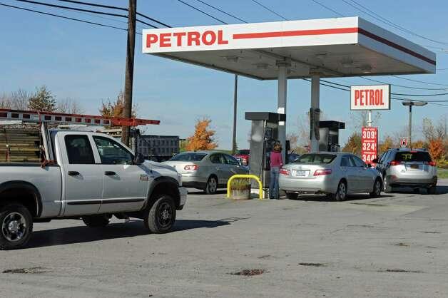 Price for regular gas is $3.09 a gallon at the Petrol gas station on 9W  Monday, Oct. 27, 2014, in Glenmont, N.Y. (Lori Van Buren / Times Union) Photo: Lori Van Buren / 00029215A