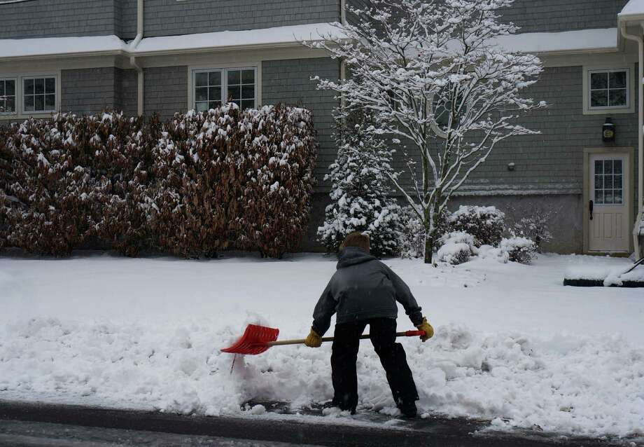 A Fairfield youth digs into snow on a sidewalk after storm in 2013. The Senior Center wants to build a network of middle school and high school students who would shovel for senior citizens and the disabled, either as volunteers or for pay. Photo: Genevieve Reilly / Fairfield Citizen