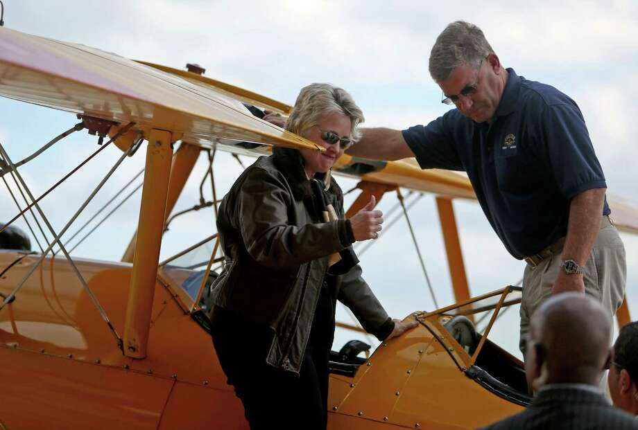 Mayor Annise Parker gives a thumbs up after taxiing in on a Boeing PT-17 Stearman Kaydet.  Photo: Gary Coronado, Staff / © 2014 Houston Chronicle