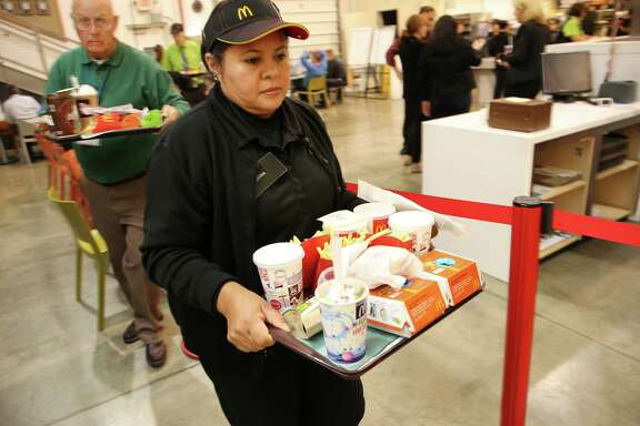 """McDonald's employees, trainees and staff work in a simulated restaurant at the McDonald's Innovation Center in Romeoville, Ill. The chain plans to introduce the """"Create Your Taste"""" offering across Australia."""