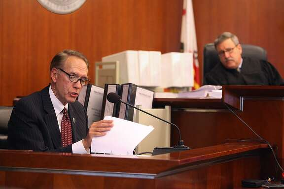 Superior court judge Curtis E.A. Karnow (right) listens to witness chancellor Brice W. Harris in the CCSF trial at the California State Superior Courthouse in San Francisco, Calif., on Monday, October 27, 2014.