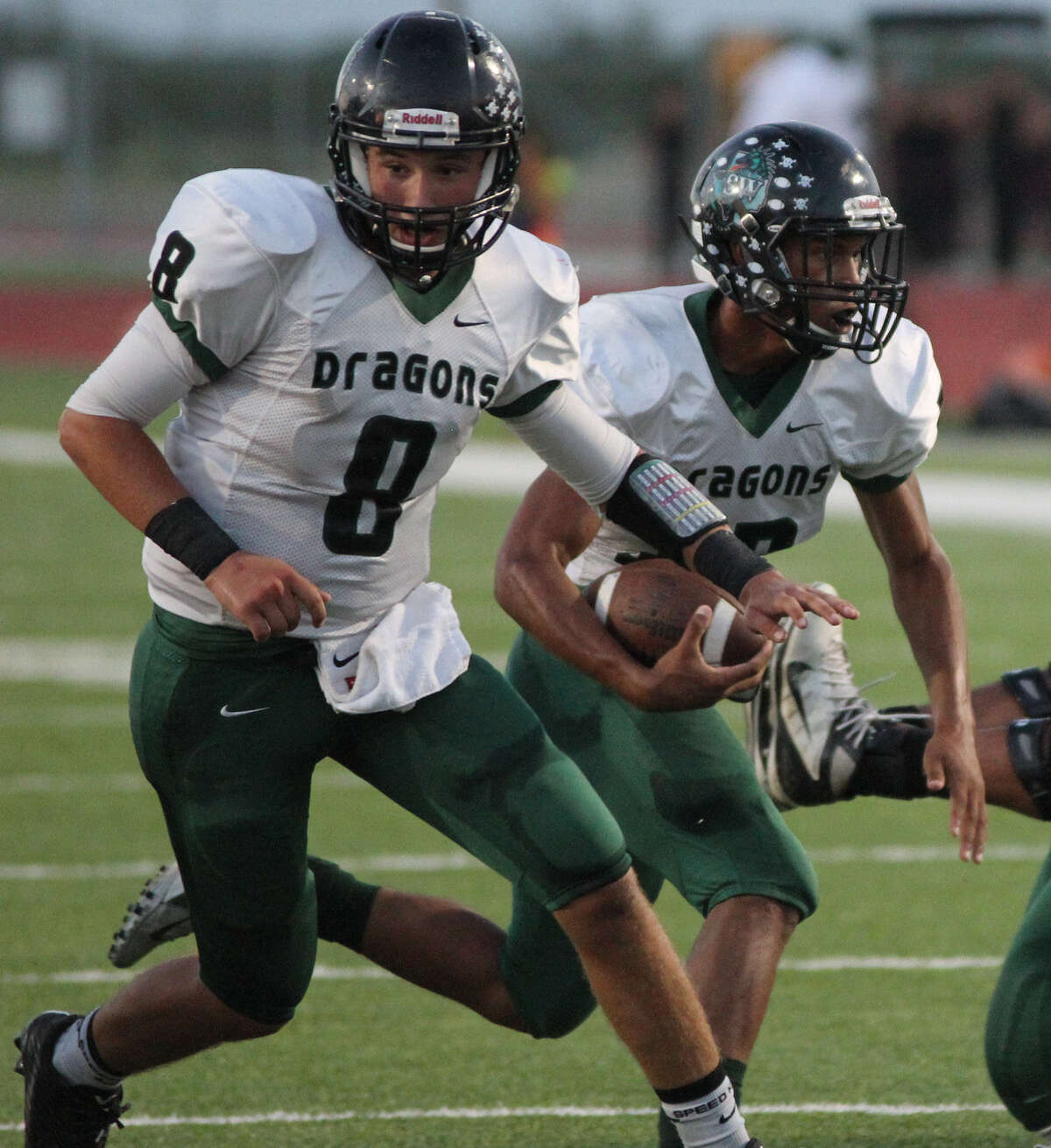 Southwest's quarterback Bowen Crisp (8) protects his running back during a game against the Eagle Pass Eagles on Sept. 26 in Eagle Pass. Southwest won, 54-44.