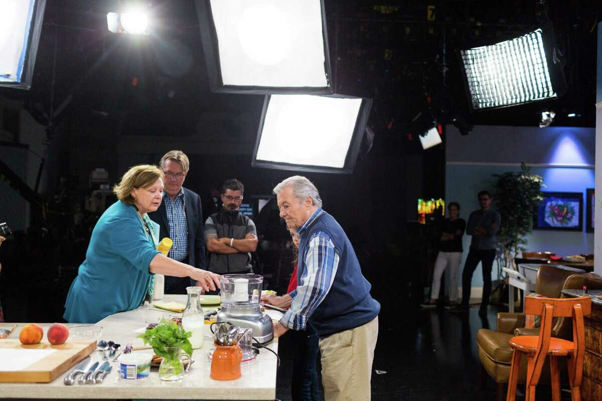"""Jacques Pepin, the French chef and host of KQED's """"Heart and Soul"""" cooking show, talks with producer Tina Salter before taping at KQED in San Francisco, Calif., Monday, October 13, 2014."""