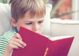 A boy reading a book. Photo: Getty