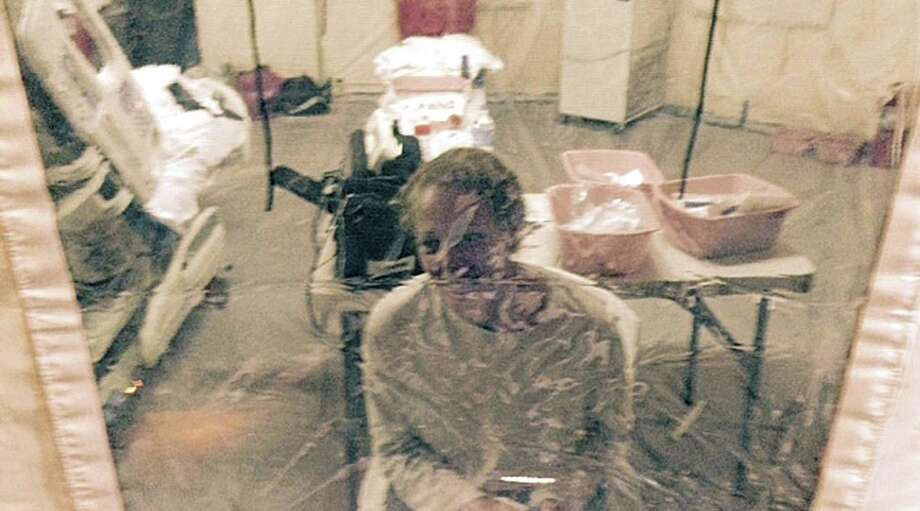 Nurse Kaci Hickox, shown in an isolation tent at University Hospital in Newark, N.J., was released Monday. Photo: Steven Hyman / Associated Press / Steven Hyman