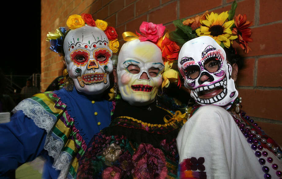 Erika Melero, Pia Ramirez and Sylvia Bazan of the Guadalupe Dance Company show their spirited faces at an early Muertitos Festival, sponsored by SAY Sí. This year's fest is Oct. 30-Nov. 1. Photo: File / San Antonio Express-News / SAN ANTONIO EXPRESS-NEWS