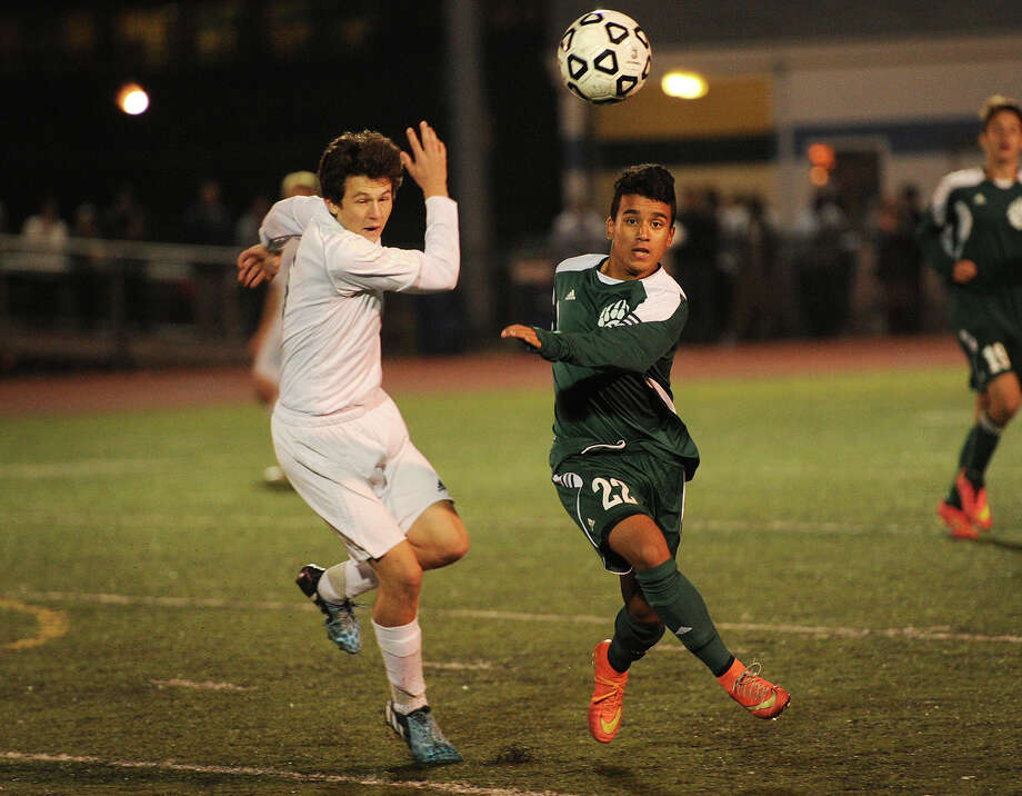 Ludlowe's Brendan Layne, left, pursues the ball with Norwalk's Cristian Moncada during their FCIAC boys soccer semifinal game at Ludlowe High School in Fairfield, Conn. on Monday, October 27, 2014. Photo: Brian A. Pounds / Connecticut Post