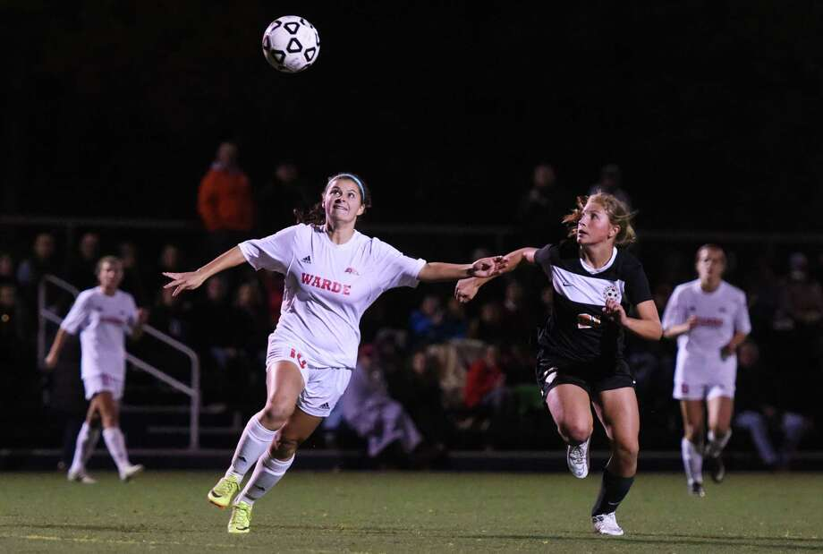 Fairfield Warde's Amelia Andrews, left, and Ridgefield's Katherine Jasminski battle for the ball in the FCIAC high school girls soccer semifinal game between No. 6 Ridgefield and No. 2 Fairfield Warde at Wilton High School in Wilton, Conn. Monday, Oct. 27, 2014. Photo: Tyler Sizemore / Greenwich Time