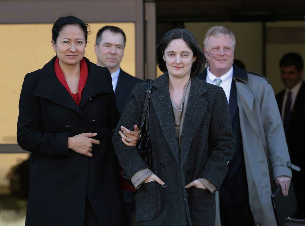 Couples Cleopatra De Leon, front left, and partner, Nicole Dimetman, and Victor Holmes, back left, and partner Mark Phariss leave the Federal Courthouse in San Antonio on Wednesday.
