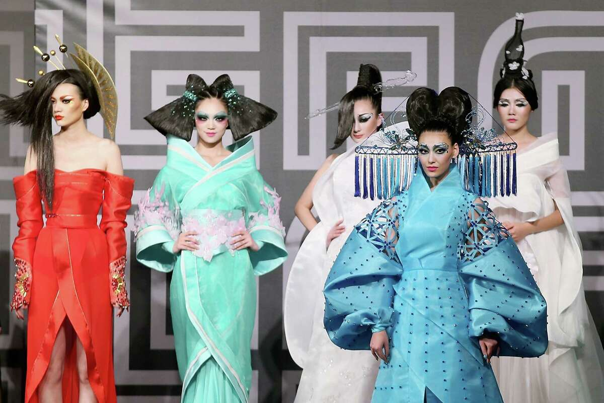 Models showcase designs on the runway at MGPIN 2015 Mao Geping Makeup Trends Launch show during Mercedes-Benz China Fashion Week Spring/Summer 2015 at Beijing Hotel on October 27, 2014 in Beijing, China.