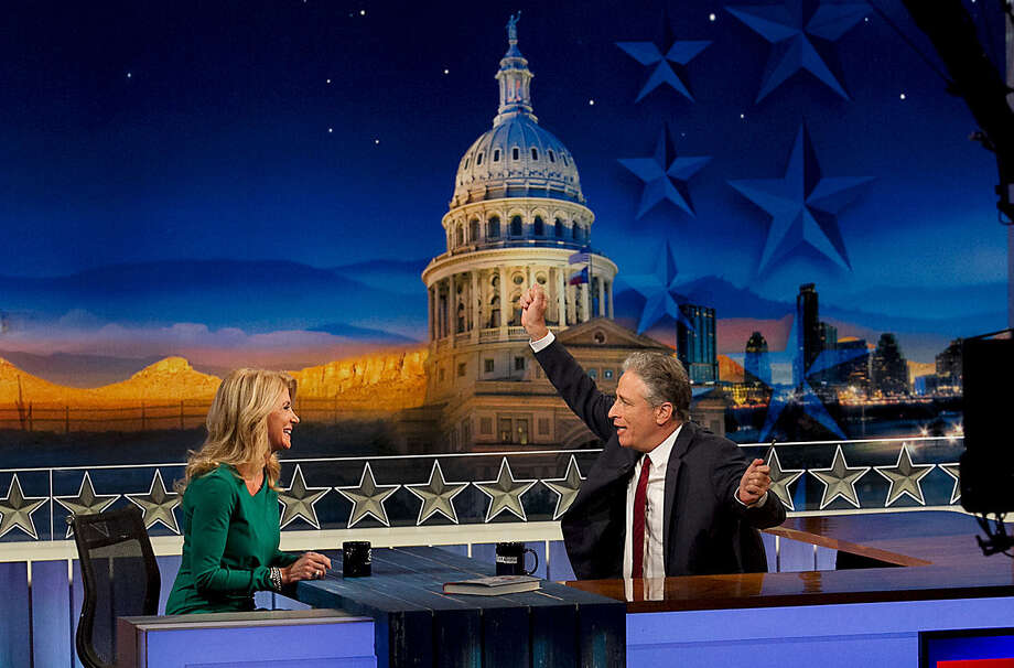"""The Daily Show""  host Jon Stewart interviews gubernatorial candidate Wendy Davis in Austin, where the show was taped Monday. Texas is ""on its way"" to being a blue state, Davis said. Photo: Ralph Barrera / Austin American-Statesman / Austin American-Statesman. State"